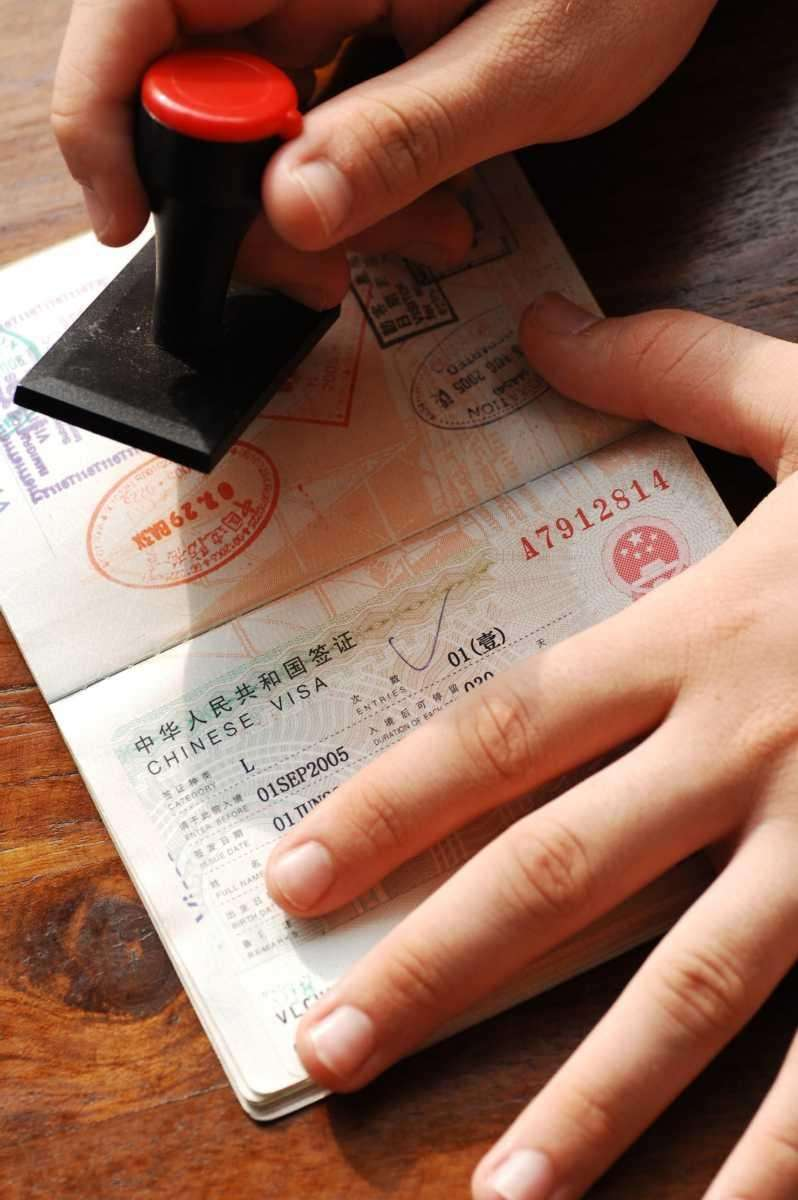 A passport shows the obligatory visa that US
