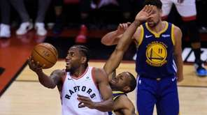 Toronto Raptors forward Kawhi Leonard (2) drives past