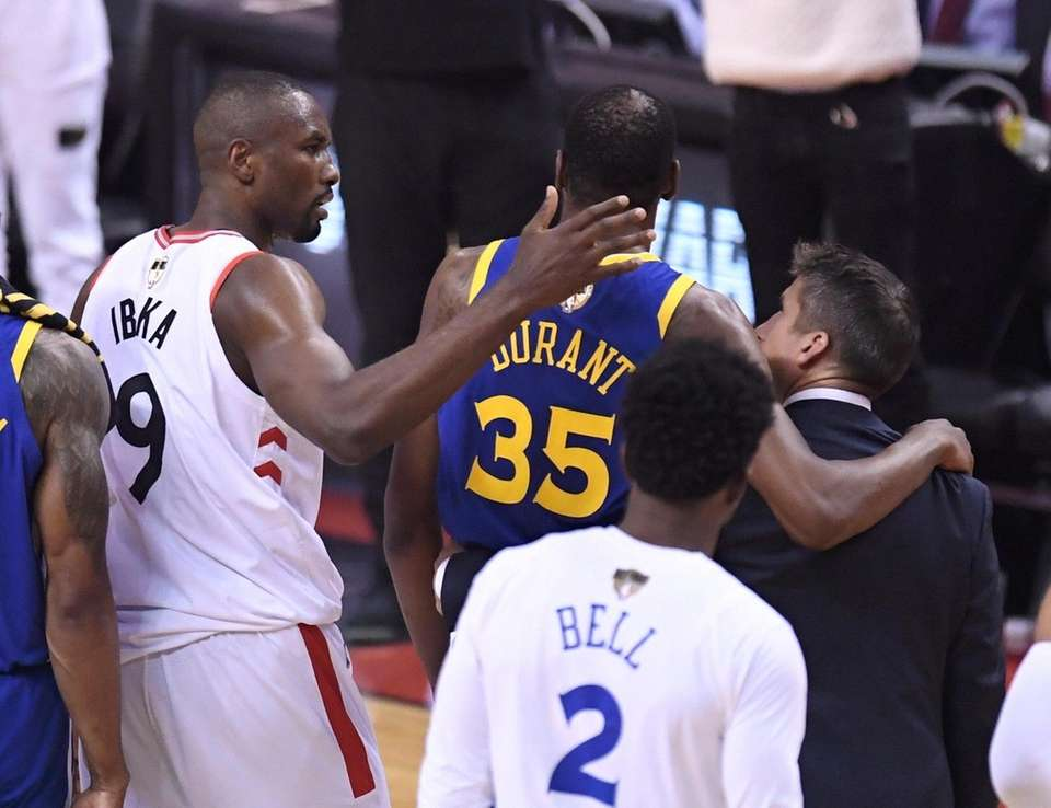 Toronto Raptors center Serge Ibaka (9) consoles Golden