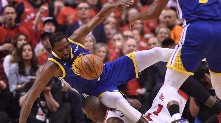 Golden State Warriors forward Kevin Durant, left, tumbles
