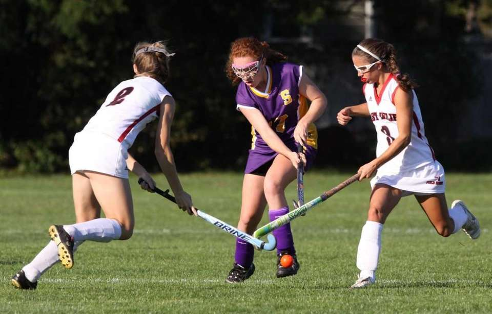 Sayville's #17 Claire Luceri, center, is defended by
