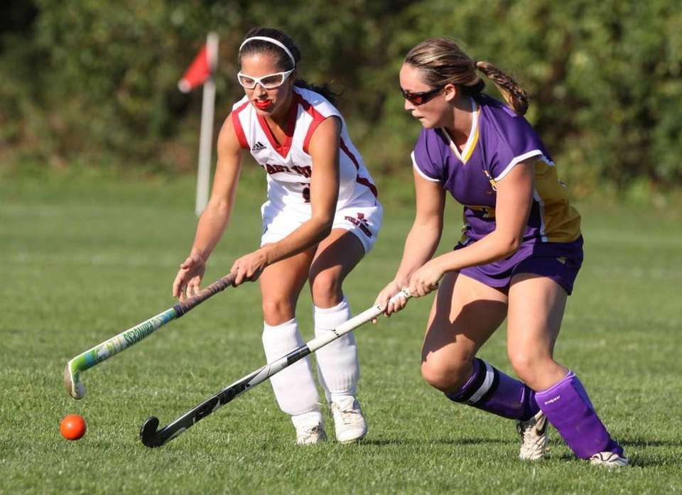 East Islip's #3 Jackie Vogelsang, left, and Sayville's