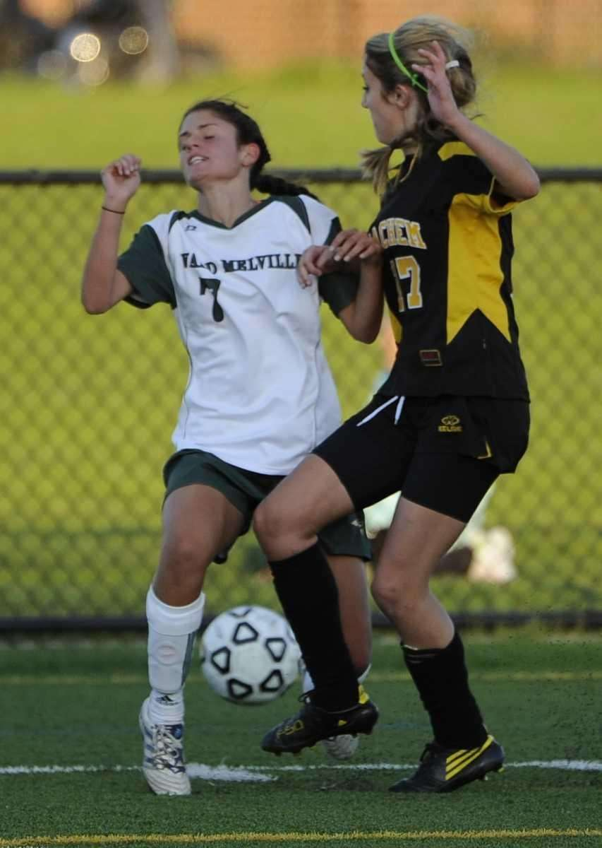 Sachem North defender Brianna Harris, left, collides with