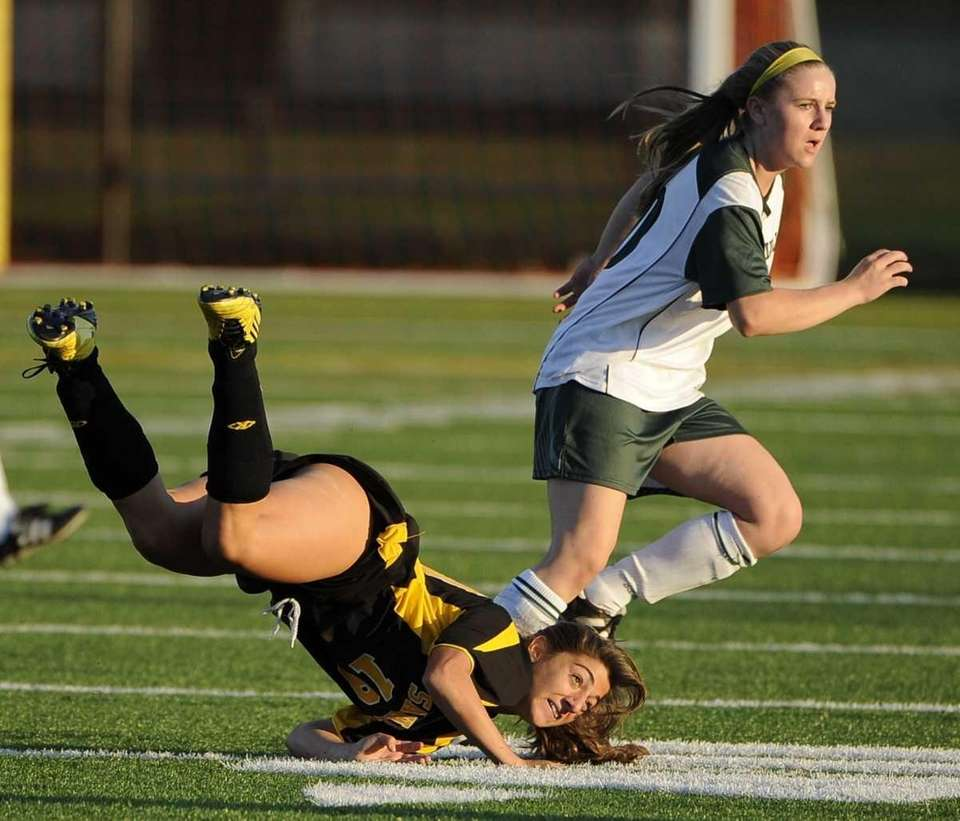 Sachem North forward Leanna Curcio, left, trips against