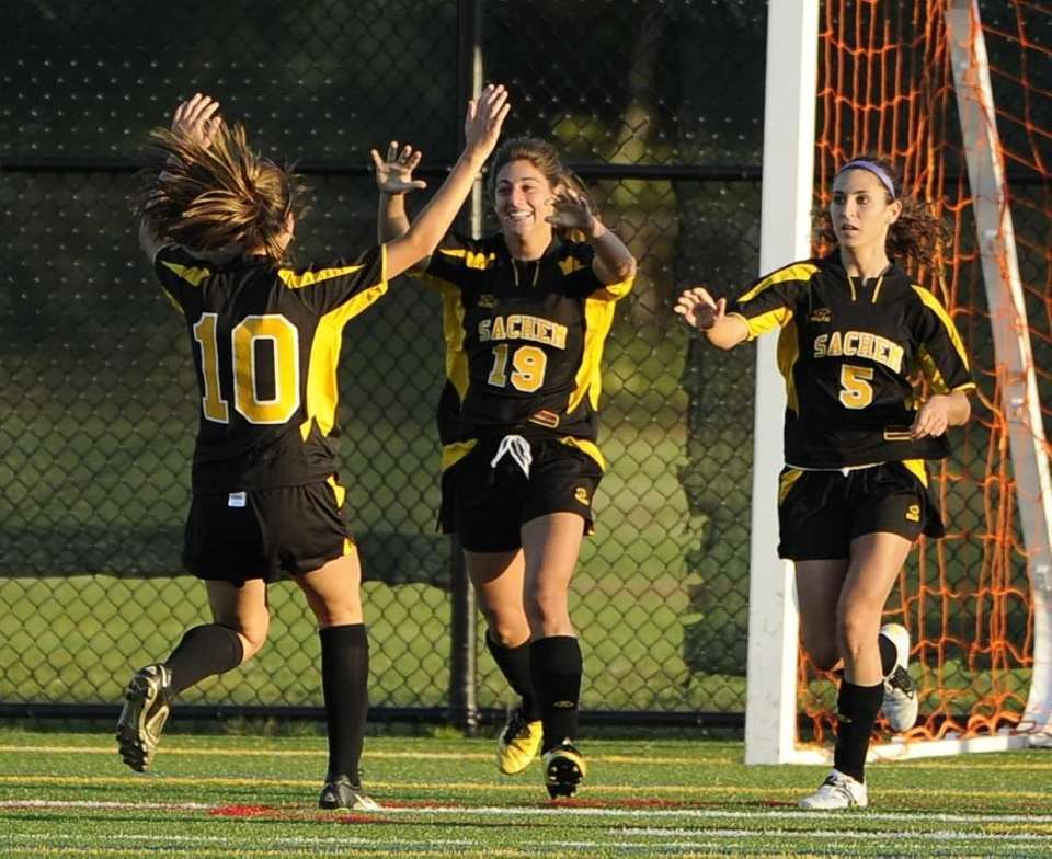 Sachem North forward Leanna Curcio, center, celebrates her