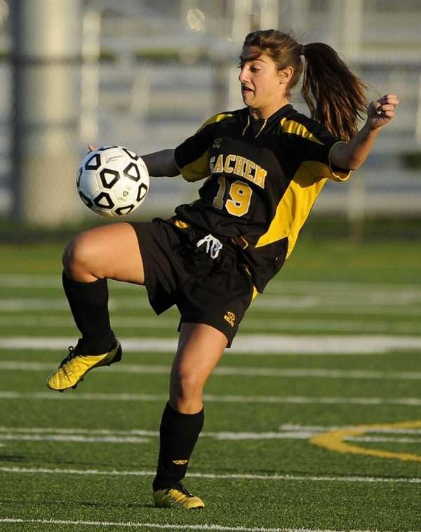 Sachem North forward Leanna Curcio traps the ball