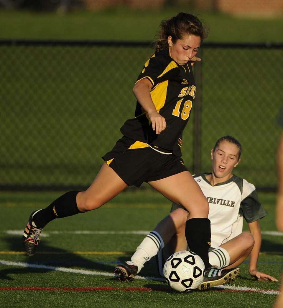 Ward Melville's Maria Sicari, right, fails to slide