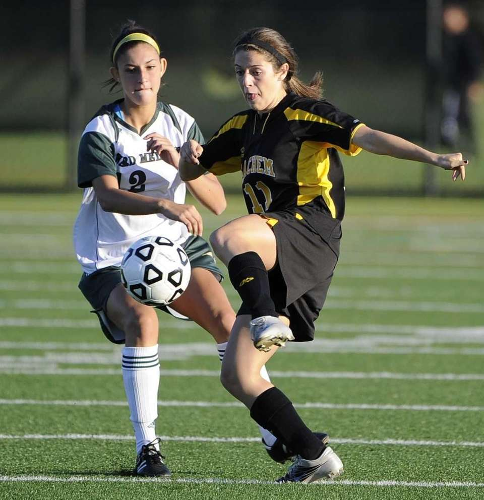 Ward Melville's Adrianna Morra, left, defends against Sachem