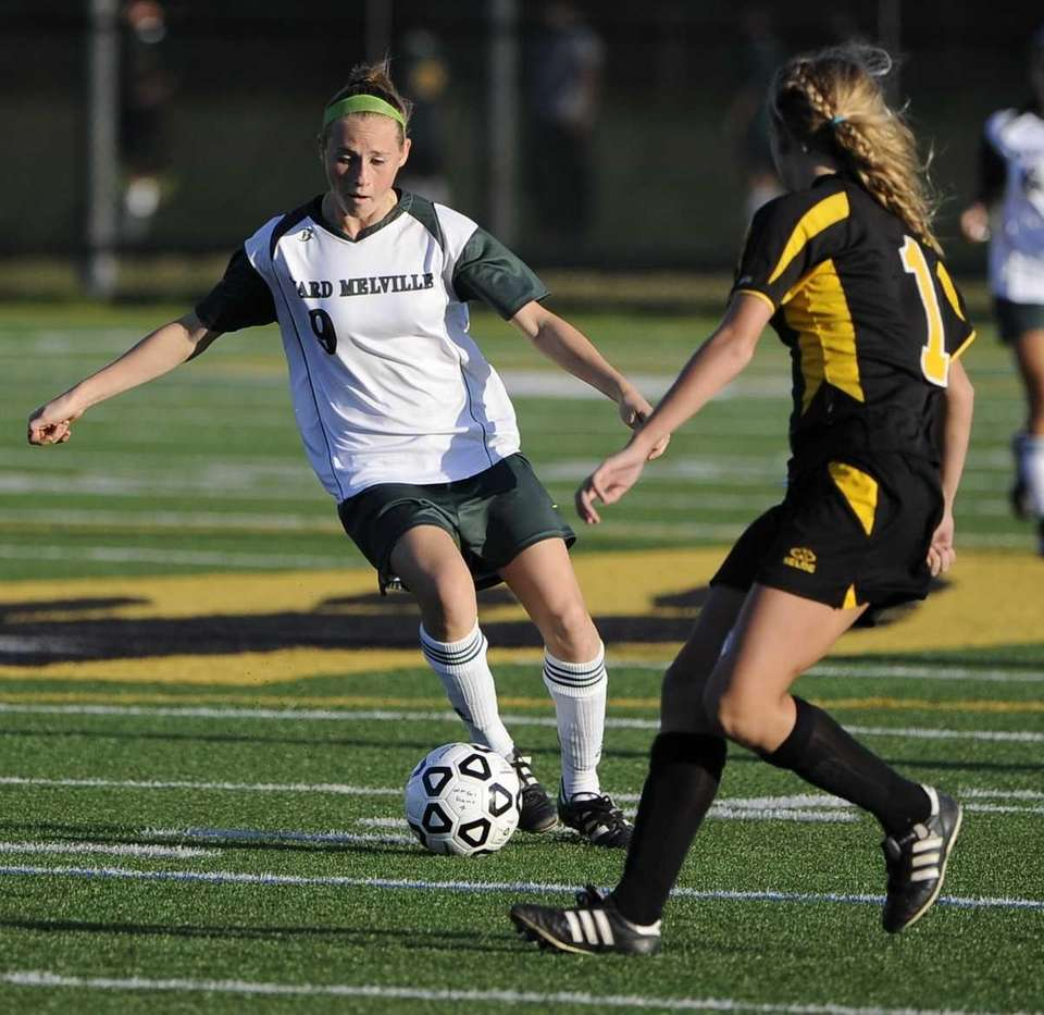 Ward Melville's Caysea Cohen controls the ball against