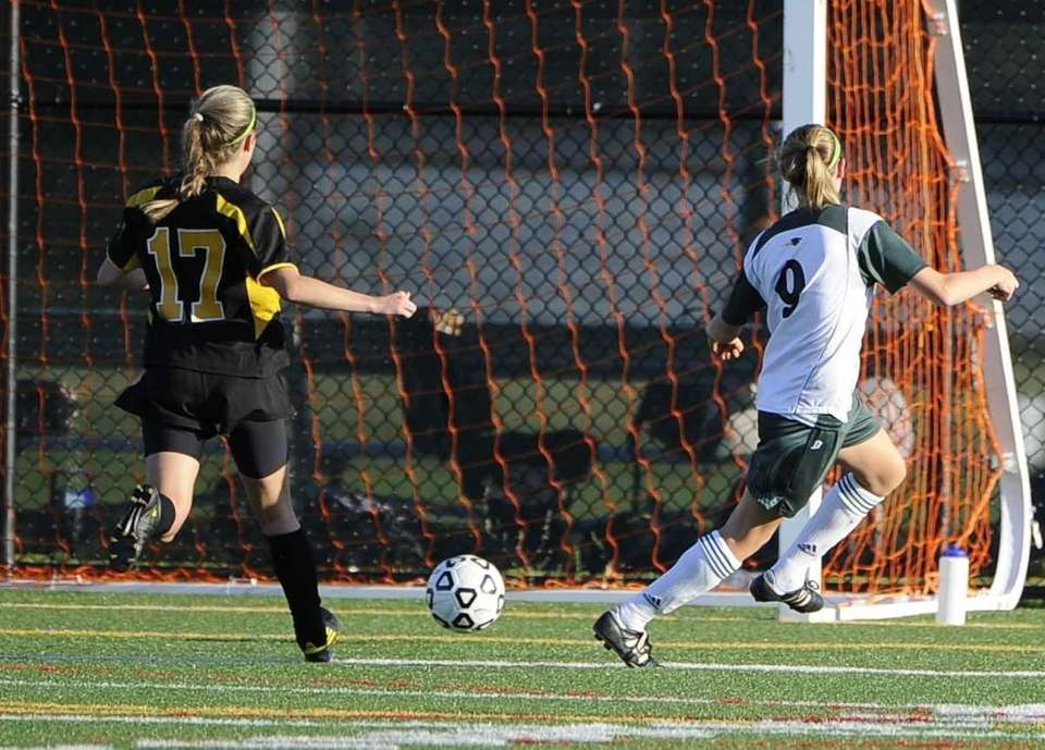 Ward Melville's Caysea Cohen, right, scores ahead of