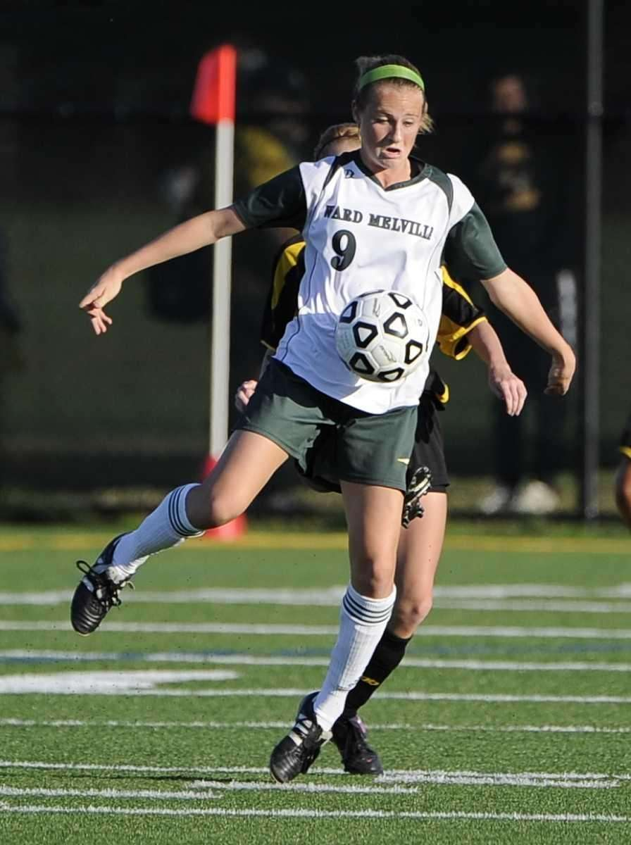 Ward Melville's Caysea Cohen traps the ball against