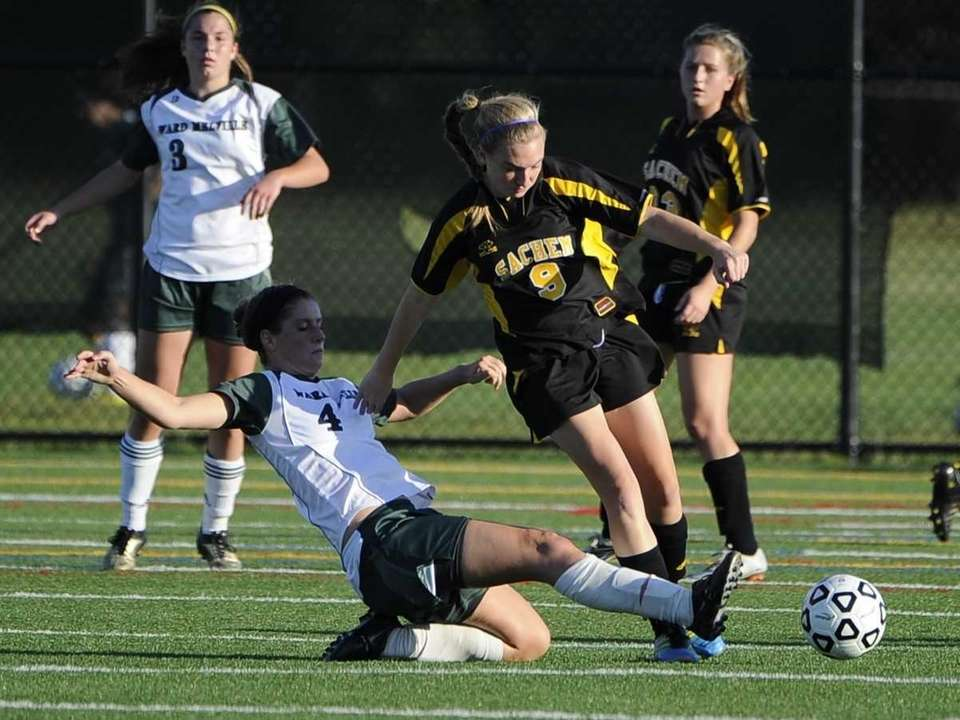 Ward Melville's Lizzy Rullan, left, slide tackles the