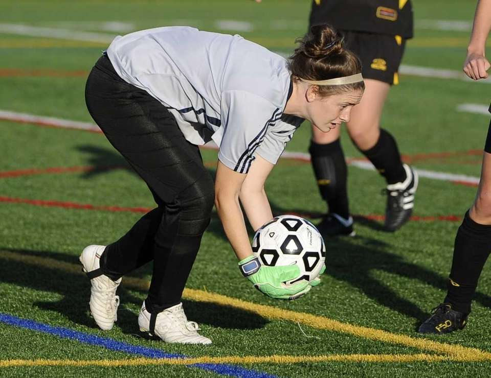 Sachem North goal keeper Erin McNulty saves a