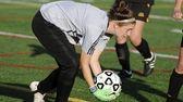 Sachem North goal keeper Erin McNulty saves a