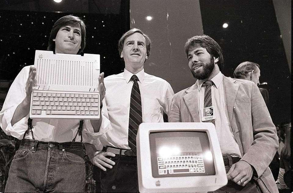 Steve Jobs, left, chairman of Apple Computer, John