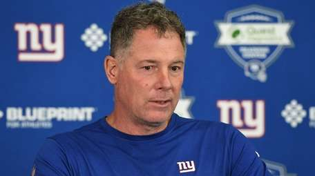 Giants head coach Pat Shurmur answers questions from