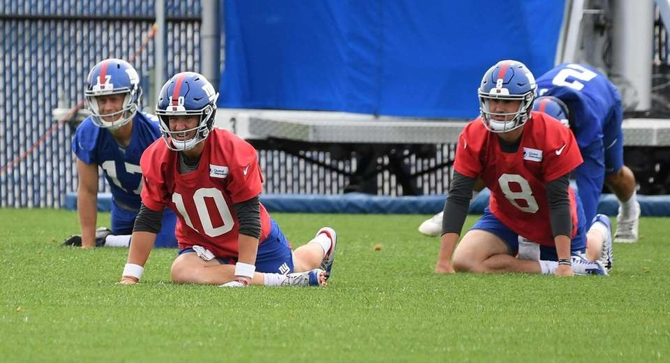 New York Giants quarterbacks Eli Manning, left, and