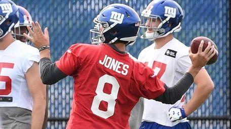 Giants quarterback Daniel Jones throws a football during