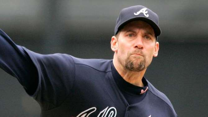 The Atlanta Braves' John Smoltz delivers a pitch