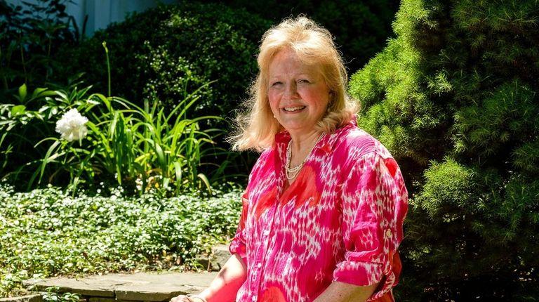 Barbara Minerd in the garden outside her home,