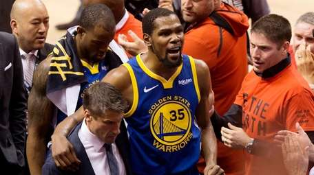 Warriors forward Kevin Durant reacts as he leaves
