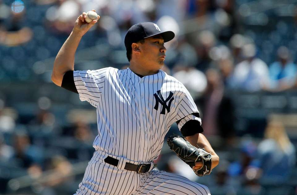 Yankees pitcher Masahiro Tanaka delivers in the first