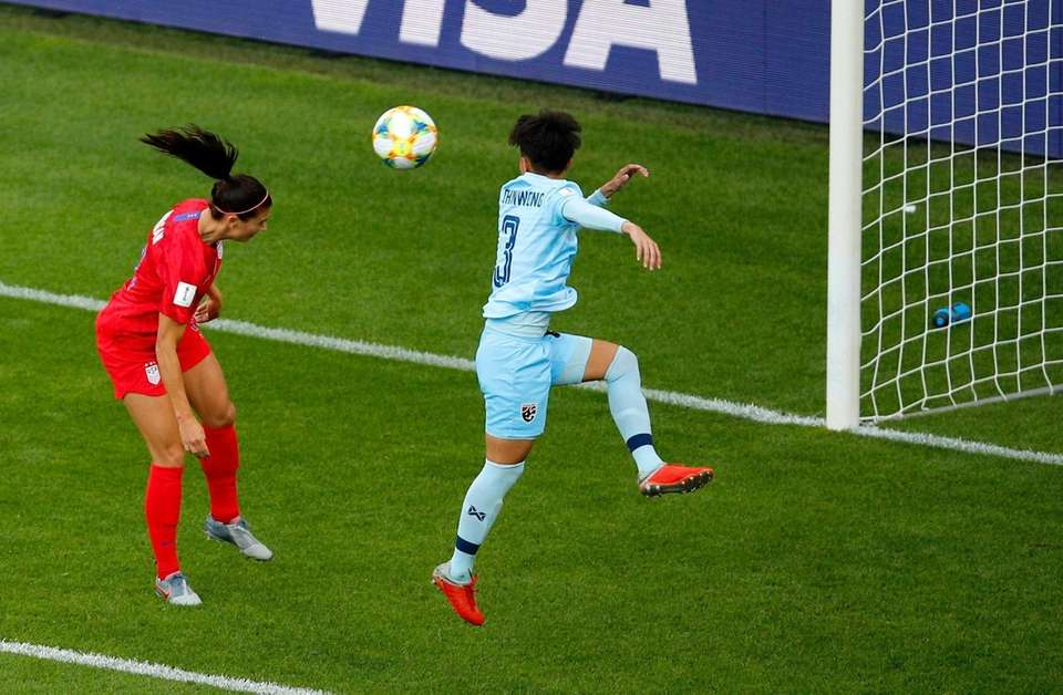 United States' Alex Morgan, left, heads the ball