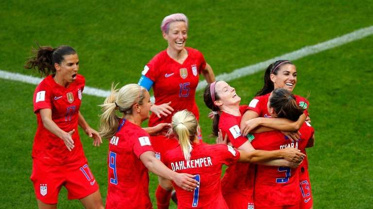 United States' Alex Morgan, right, celebrates with her