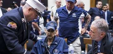 From left, retired FDNY Lt. Michael O'Connell, a