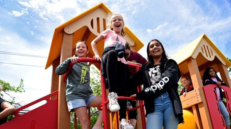 Fifth-graders Ava Bassolino, Lauren Marino and Nabiha Ameer,