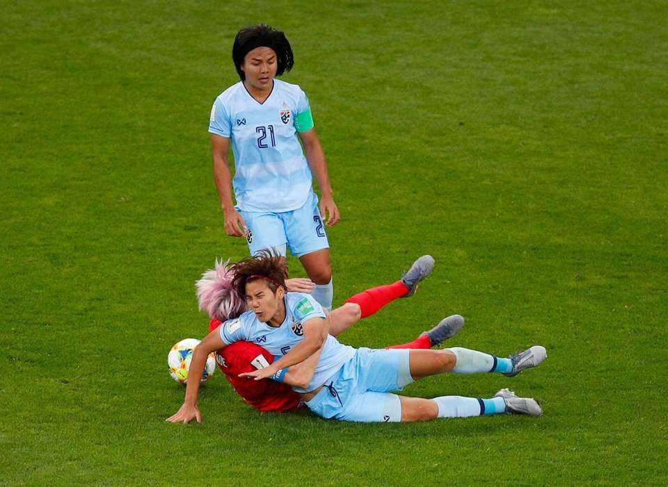 United States' Megan Rapinoe collides with Thailand's Ainon