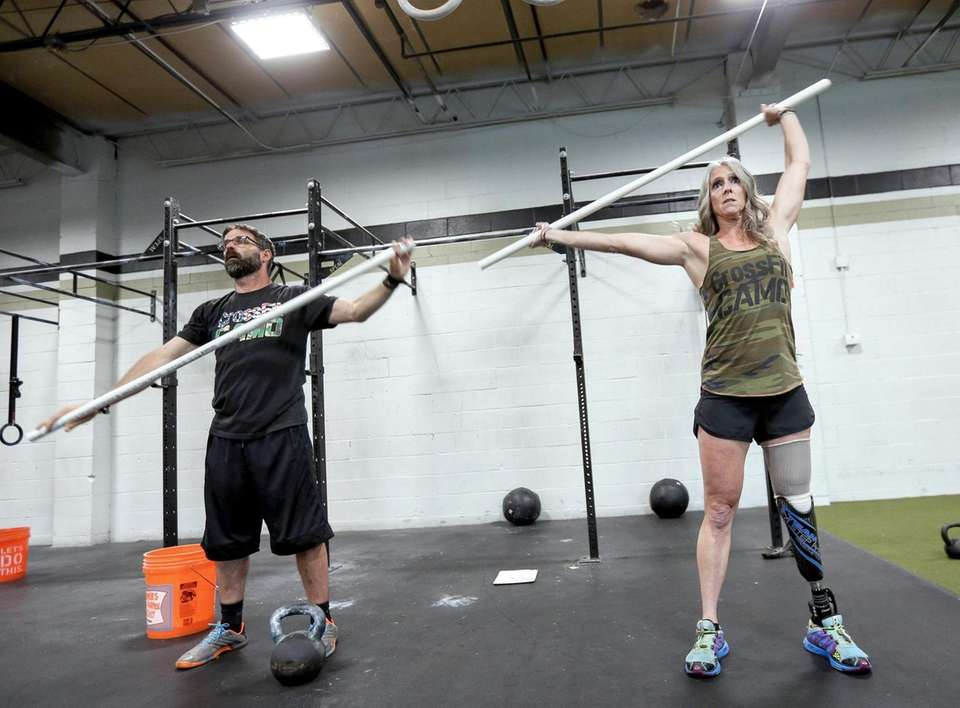 Amy Palmiero-Winters stretches with fiance Christopher Acord Monday
