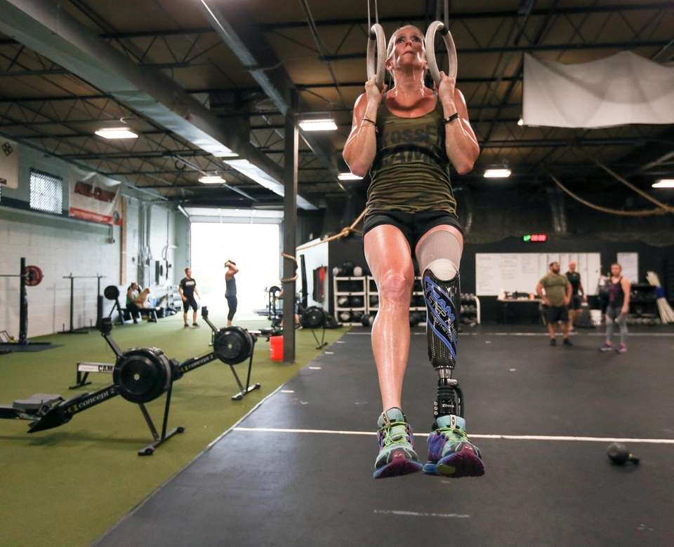 Amy Palmiero-Winters works out on Monday at CrossFit