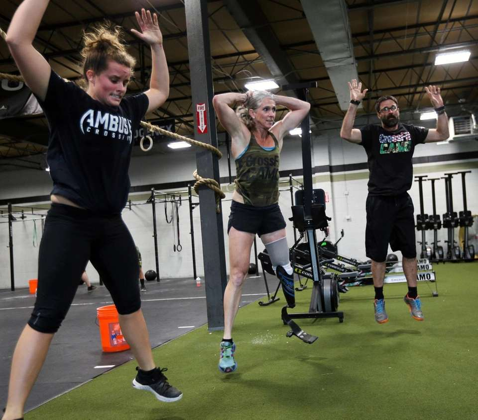 Amy Palmiero-Winters does burpees with workout partners at