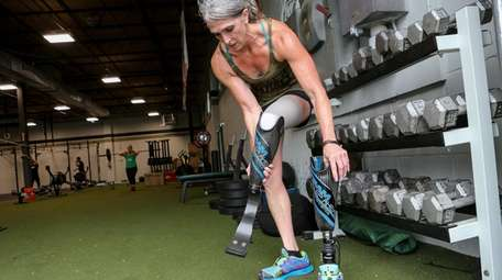 Amy Palmiero-Winters changes her prosthetic leg during her