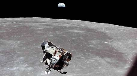 The lunar module approaches for docking with the