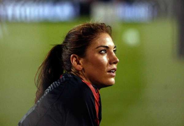 U.S. goalkeeper Hope Solo warms up against Canada