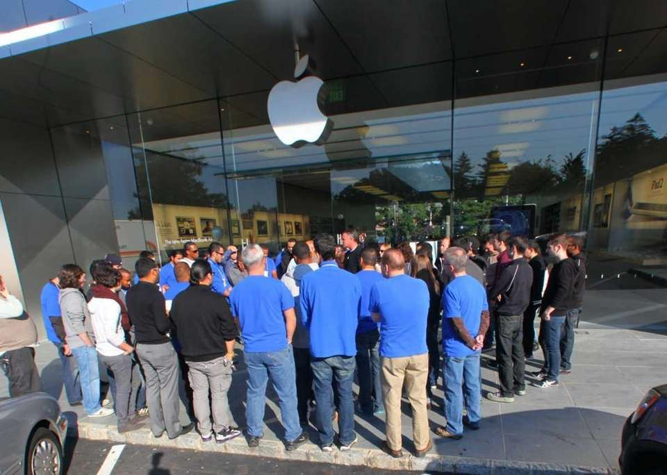 Staff members at the Apple store in Manhasset