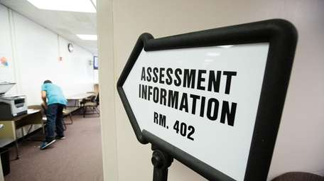 A sign for assessment information is pictured at