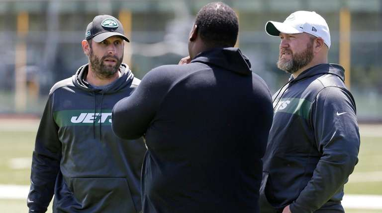 Jets general manager Joe Douglas, right, and head