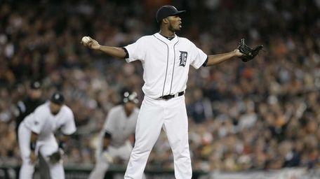Detroit Tigers relief pitcher Al Alburquerque reacts after