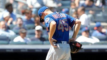 Zack Wheeler #45 of the Mets walks to