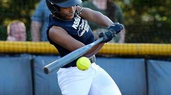Nassau all-star Akemi Poyer bats in a game