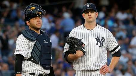 Austin Romine, left, and James Paxton of the