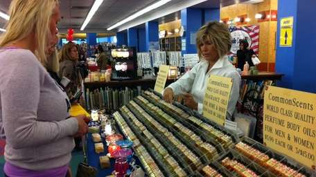 Pam Penta of East Moriches helps customers pick