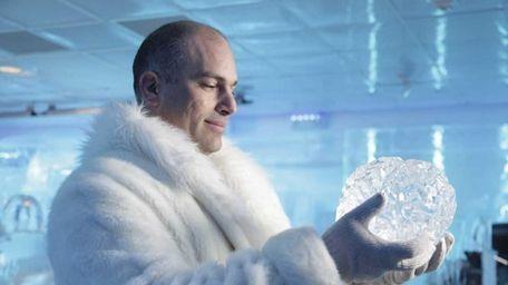 Dr. Amir Raz holds an ice sculpture of