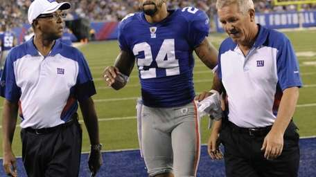 New York Giants' cornerback Terrell Thomas injured his