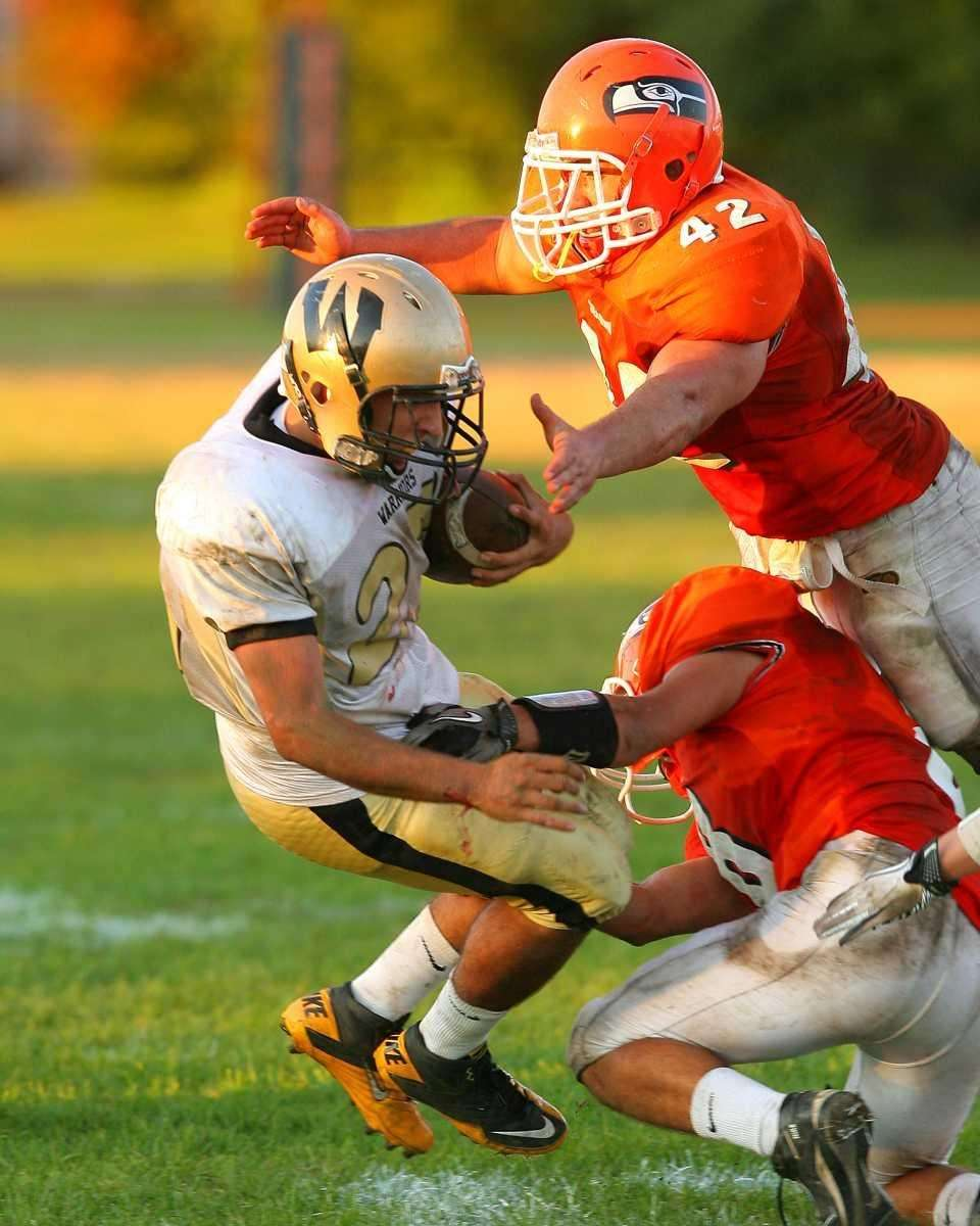Wantagh HS's Matt Balzano #23 gets tackled by