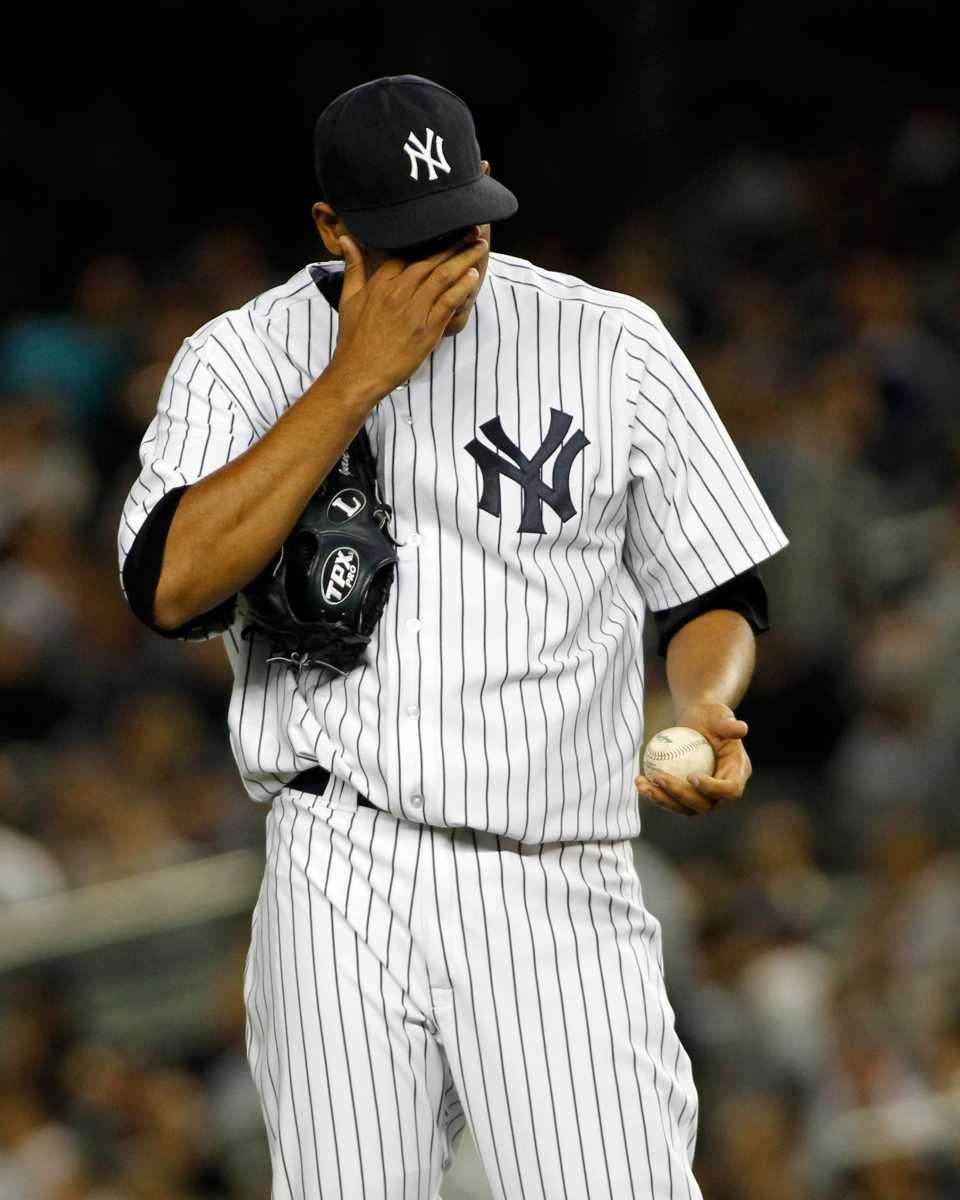 New York Yankees' Ivan Nova #47 rubs his