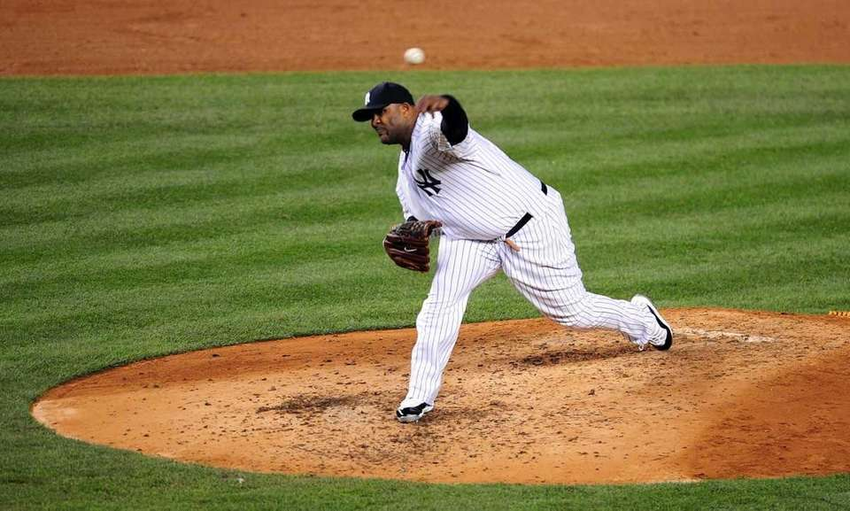 New York Yankees pitcher CC Sabathia throws in